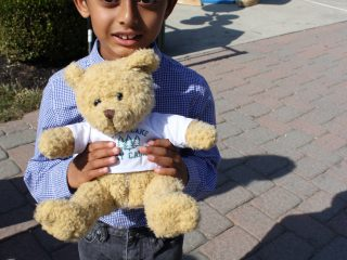 This new camper gives his SLDC teddy bear an extra tight squeeze at our Fall Fest!
